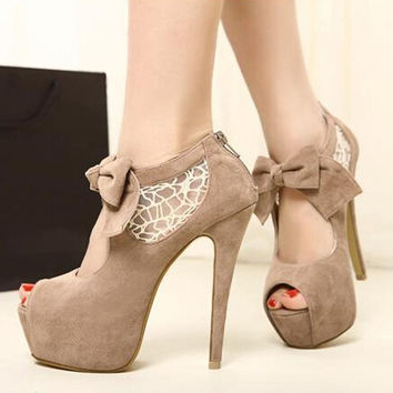 Hollow out bowknot pure color high heels