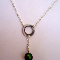 Minimalist sterling silver  chain necklace with open ring center and hanging swarovski pearl.