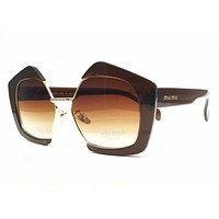 Miu Miu MU10RS Sunglasses Light Havana w/Brown Gradient Lens 7S01G0 SMU10R