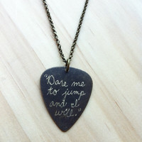 "Engraved Brass Guitar Pick Necklace - Tom Waits song lyric ""Dare me to jump and I will."""