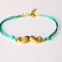 "Minimalist Bracelet gold plated moustache with green string Alexander Henry's ""Where's my Stache"""