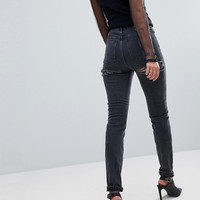 ASOS TALL FARLEIGH High Waist Slim Mom Jeans In Washed Black with Bum Rips at asos.com