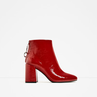 HIGH HEEL ANKLE BOOTS WITH METALLIC PULL TAB