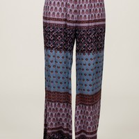 A stylish gauze fabrication wide leg fit defines these breezy floral print pants with a flowy, boho chic vibe that doesn't play down the sophistication, elasticized waist band. Unlined.