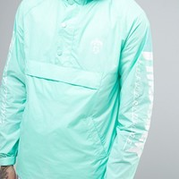 HUF x Thrasher Overhead Packable Windbreaker at asos.com