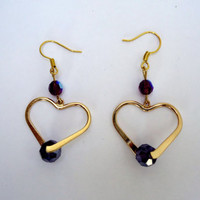 Open Heart Gold Tone earrings with faceted crystals in purple on gold tone ear wires. Handmade.