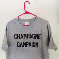 Champagne Campaign T-Shirt - Grey T-Shirt w/ Black Lettering Graphic Saying
