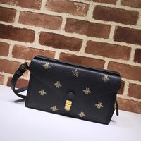 Gucci women Leather pouch black bag