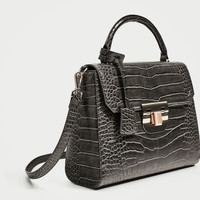 EMBOSSED CITY BAG WITH FASTENING DETAIL