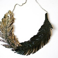 Supermarket: Golden Dipped, Black Feather Necklace - Black Leather, Gold Leather and Gunmetal Chain from Love at First Blush