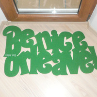 Be nice or leave floormat. Rug with a customized message.