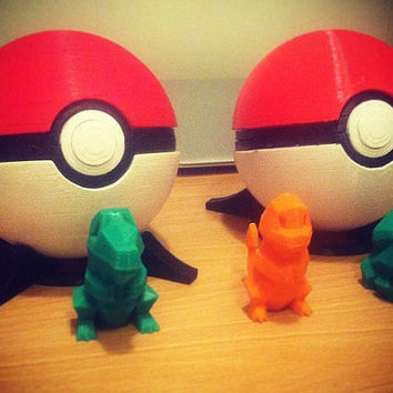 Full Size Pokeball (With working push button release), Includes stand and free Pokemon Minature!