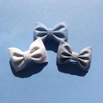 Grey anchor, blue chambray, and white linen hair bows from Seaside Sparrow.  Our anchor fabric is limited and super cute.