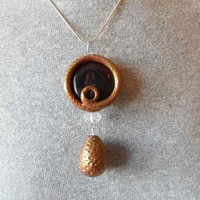 golden dragon egg pendant with polymer clay and agate bead