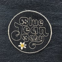 Blue Jean Baby embroidered patch made from recycled vintage denim 3 1/2 inches iron on blue white retro 70's
