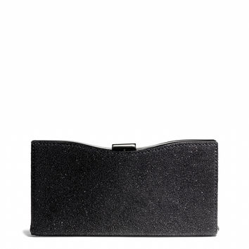 madison frame clutch in caviar leather