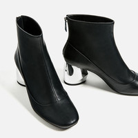 ANKLE BOOTS WITH METAL HEEL DETAILS