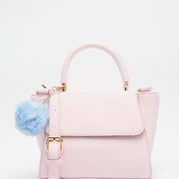 Pink | Skinnydip Small Cross Body in Pink With Pom Pom at ASOS