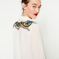 BLOUSE WITH SEQUINNED YOKE