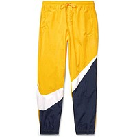 Nike Men's Sportswear NSW Swoosh Woven Yellow Navy Pants