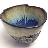 Ivory Crystalline Glaze Cup with Bright Blues and Purples. Hand made from porcelain, one of a kind. 4 in sq x 3 in tall. Dishwasher safe