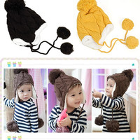 Warm Winter Knit Hat with Hanging Pom Poms