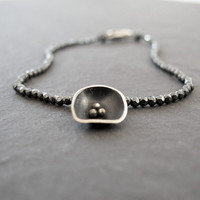 Black flower bracelet with faceted 2 mm hematite and silver flower