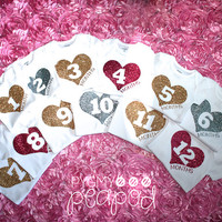 First 12 Months Hearts - Baby Month Birthday - Monthly Baby Bodysuits Set - 1-12 Months Old - Set of 12 Bodysuits - White with Gold Glitter