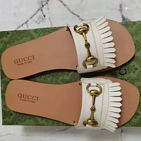Gucci's new horse clasp flat bottomed slippers