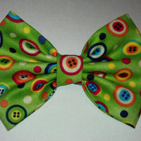 Green hair bow with cute colorful buttons, perfect for any occasion