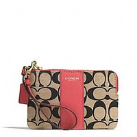 LEGACY L-ZIP SMALL WRISTLET IN PRINTED SIGNATURE COATED CANVAS