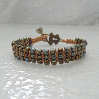 Brown beaded boho chic bracelet with antique bronze key toggle clasp, hand knotted bracelet bohemian jewelry