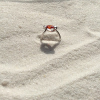 Romantically wrapped warm Amber colored stone. Original design inspired by the beauty of a wrapping ribbon, high polished sterling silver