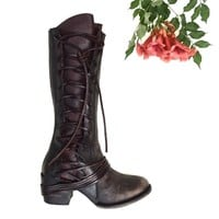 These genuine leather boots feature a corset style side lace up design, round toe silhouette, distressed leather, and stacked block heel. Finished with cushioned insole, soft leather interior lining, and full-length side zipper closure for easy on/off and
