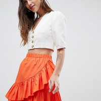 ASOS DESIGN cotton mini skirt with wrap detail at asos.com