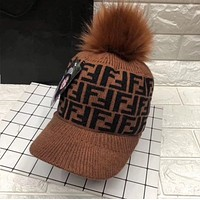 Fendi Fashionable wool knitted cap with F-label wool to keep warm ostrich hair ball mink hair ball cap woman