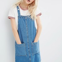 ASOS Denim Mini Pinafore Dress In Mid-Wash Blue at asos.com