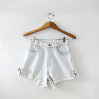 Vintage 80s light wash jean shorts. Bow tie jean shorts. High waist denim shorts. Cut off bleached denim shorts. Frayed jean shorts.