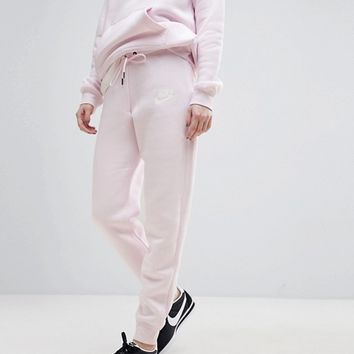 Nike Rally Tight Fit Sweat Pants In Pearl Pink at asos.com
