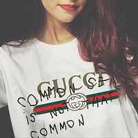 GUCCI street fashion men and women models graffiti letters loose wild half sleeve t-shirt White