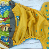 Avengers, PK (Marigold outer, two-toned snaps- Marigold caps/Aqua pieces) Wrap Around, OS Pocket DiaperInstock and ready to ship
