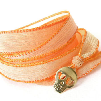Silk wrap bracelet with handcrafted skull button in tangerine, orange, fashion jewelry, hand dyed silk ribbon fabric  jewelry