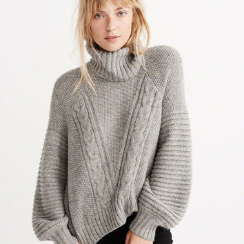 PUFF SLEEVE CABLE TURTLENECK SWEATER