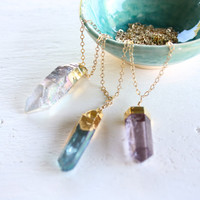 TenThings. blue quartz. CRYSTAL BULLET. long gold chain. necklace.