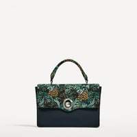 CITY BAG WITH INTERCHANGEABLE FLAP DETAILS
