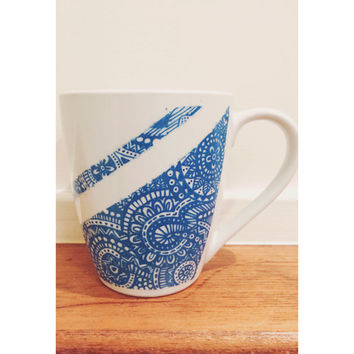 mug decorated with oil sharpie - blue mandala design on it