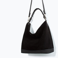 Leather bucket bag with braided handle