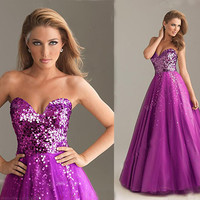 Charming purple sweatheart strapless floor-length prom dress from Girlfirend
