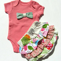 Baby girl coral Onesuit with green bow and frilly white and pink pants