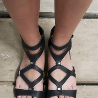 Take It Up A Notch Black Vegan Leather Flat Gladiator Sandals